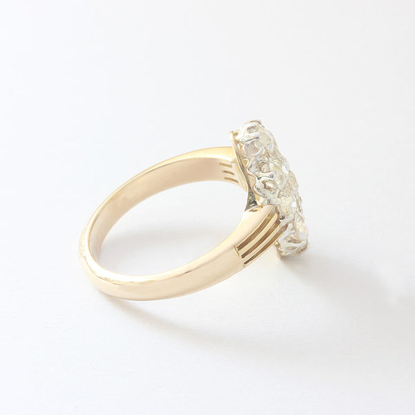 a beautiful diamond cluster marquise shaped ring in yellow gold