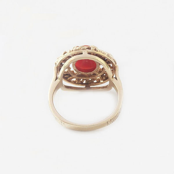 a vintage yellow gold coral set nest design ring