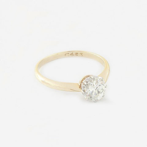 a beautiful diamond set solitaire claw set ring engagement in gold and platinum  Edit alt text
