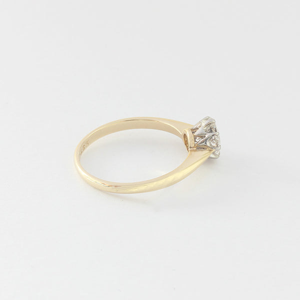 a gold and platinum diamond set single stone engagement ring in a claw setting
