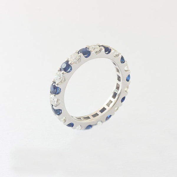 a secondhand sapphire and diamond full eternity ring in white gold