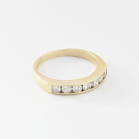 a secondhand diamond set half eternity ring with a channel setting
