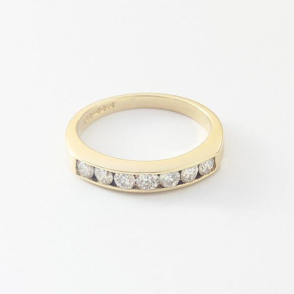 a preowned seven stone round diamond set half eternity ring in yellow gold