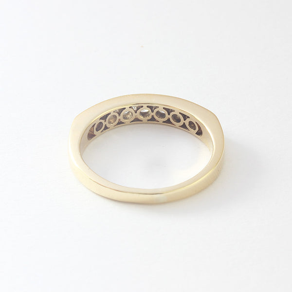 a secondhand yellow gold diamond set half eternity ring