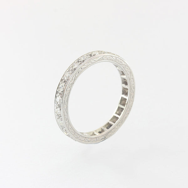 a beautiful secondhand platinum set diamond full eternity ring with scroll detailed edges