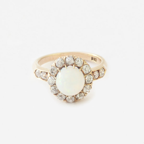 a secondhand cluster ring yellow gold opal centre and diamond surround