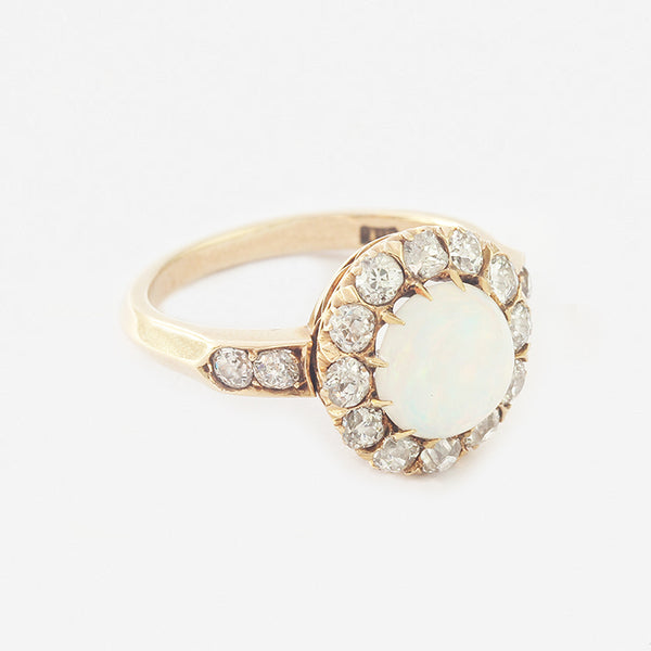 a secondhand opal and diamond yellow gold cluster ring