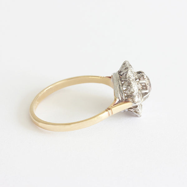a secondhand gold and silver cinnamon and white diamond ring