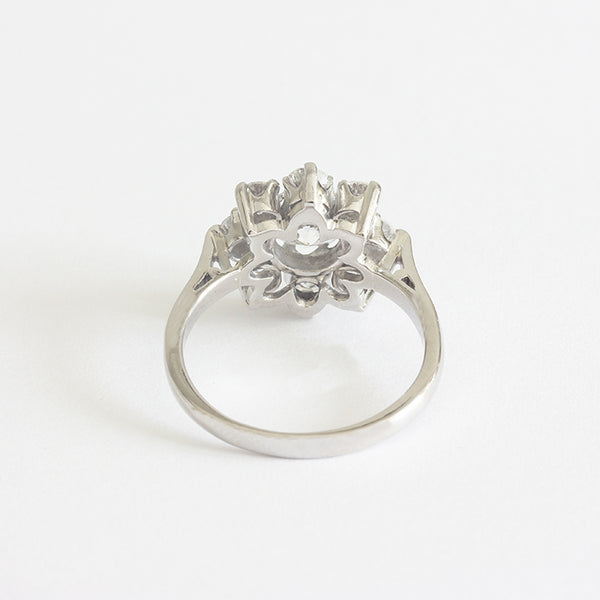 a beautiful diamond set cluster ring claw setting and in platinum