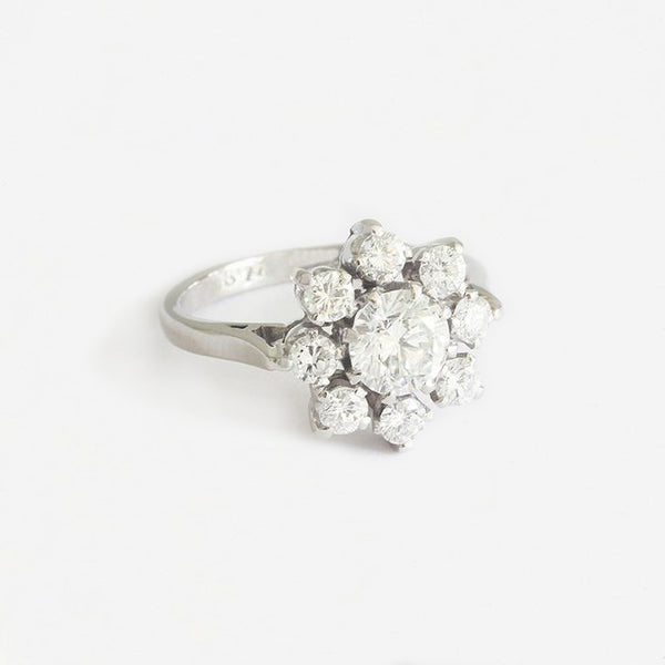 a beautiful diamond 9 stone flower shaped cluster ring in platinum secondhand