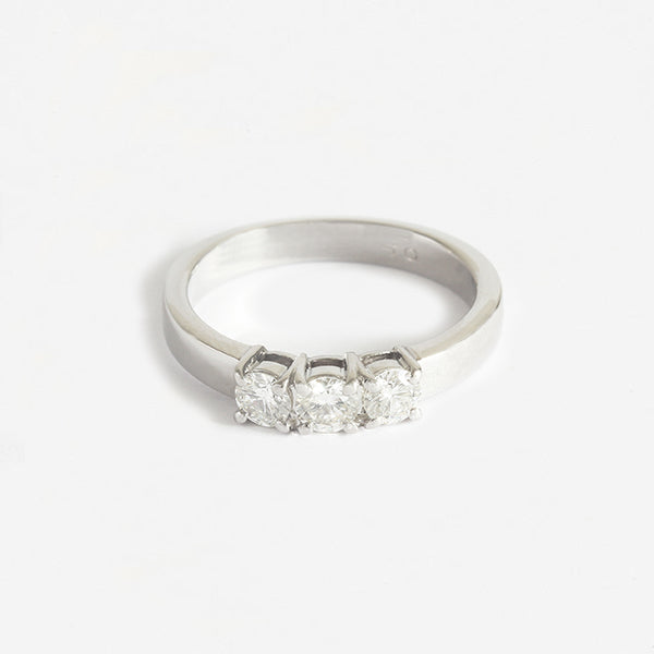 a 3 stone diamond ring in platinum with a claw setting