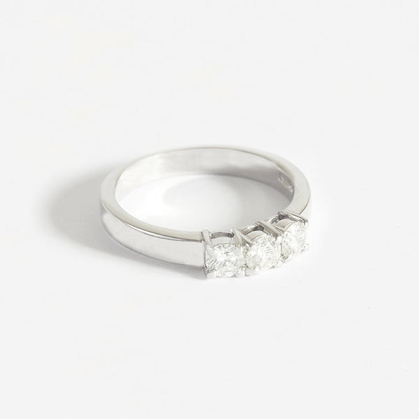 a beautiful platinum 3 stone diamond round stone ring in claw setting