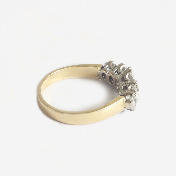 a diamond 5 stone ring in gold with claw settings