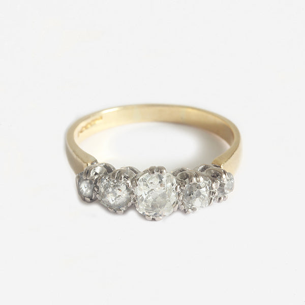 a preowned lovely diamond set 5 stone graduated ring