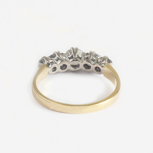 a gold secondhand 5 stone ring with diamonds graduating in a claw setting