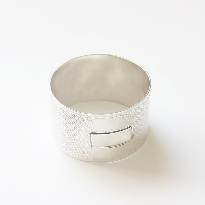 a silver vintage napkin ring engine turned with plain bar for engraving