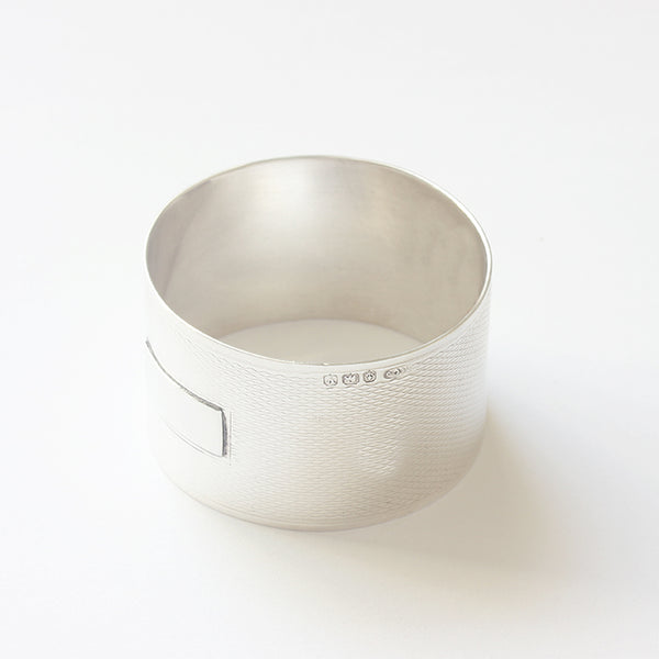 an engine turned round hallmarked silver napkin ring with space for engraving