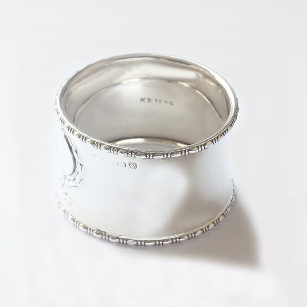 a secondhand napkin ring with patterned edges and plain motif solid silver