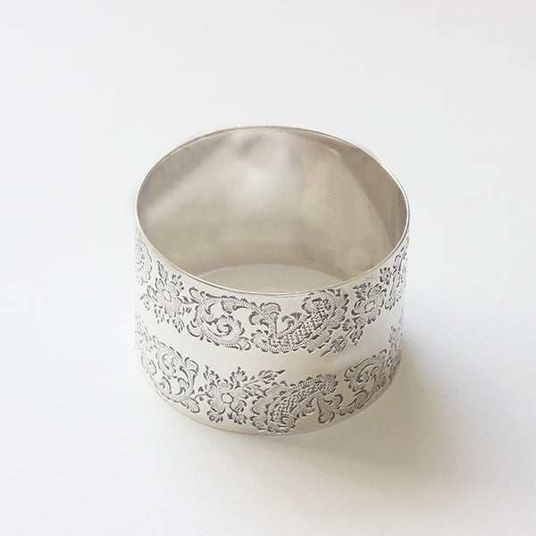 a floral and scroll design victorian silver napkin ring