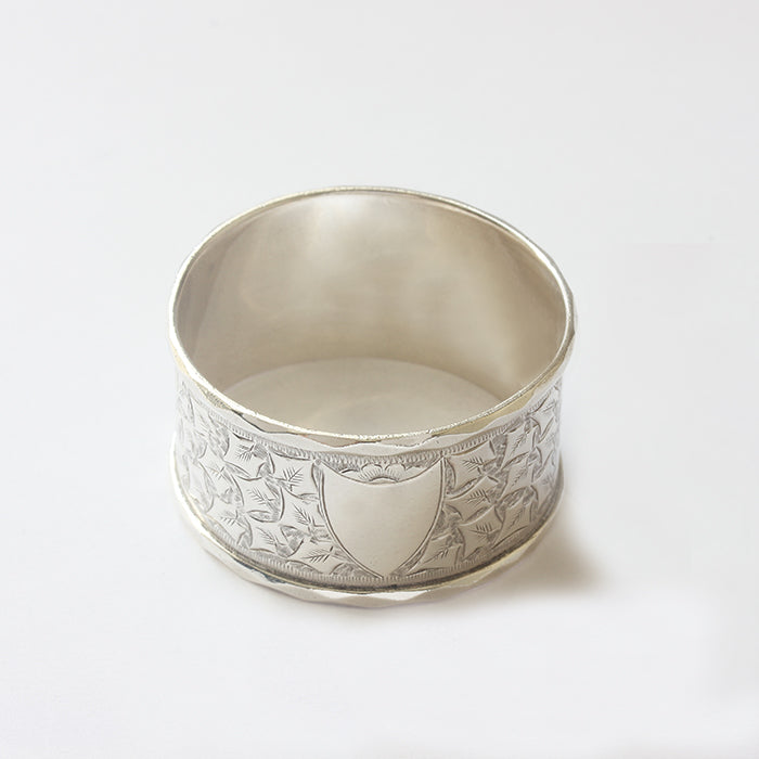 a victorian silver napkin ring with leaf pattern and plain shield motif for engraving