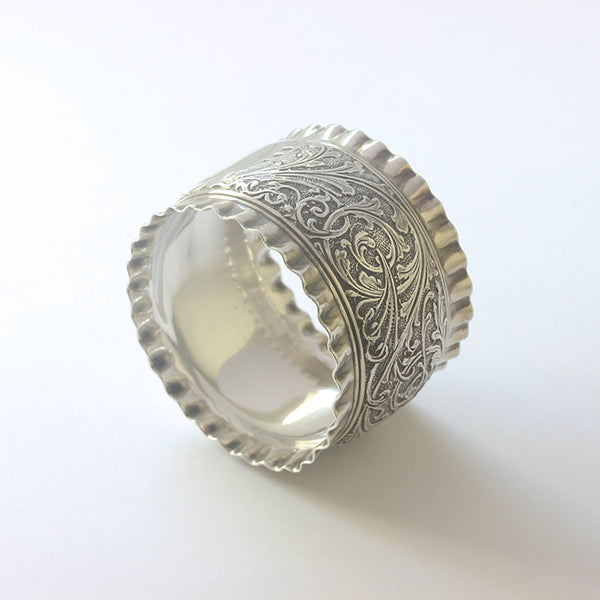 a preowned solid silver victorian napkin ring with leaf pattern and plain motif