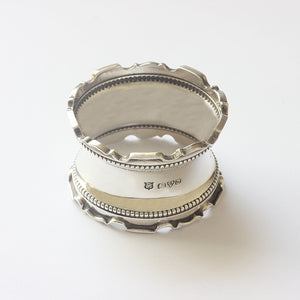 a silver napkin ring with hallmark for Chester 1914 solid silver beaded edge