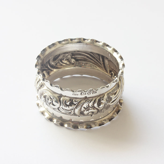 a silver engraved edwardian napkin ring with Nellie inscribed date 1901