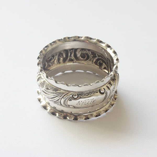 a beautiful engraved patterned silver napkin ring dated 1901 with the name nellie on it