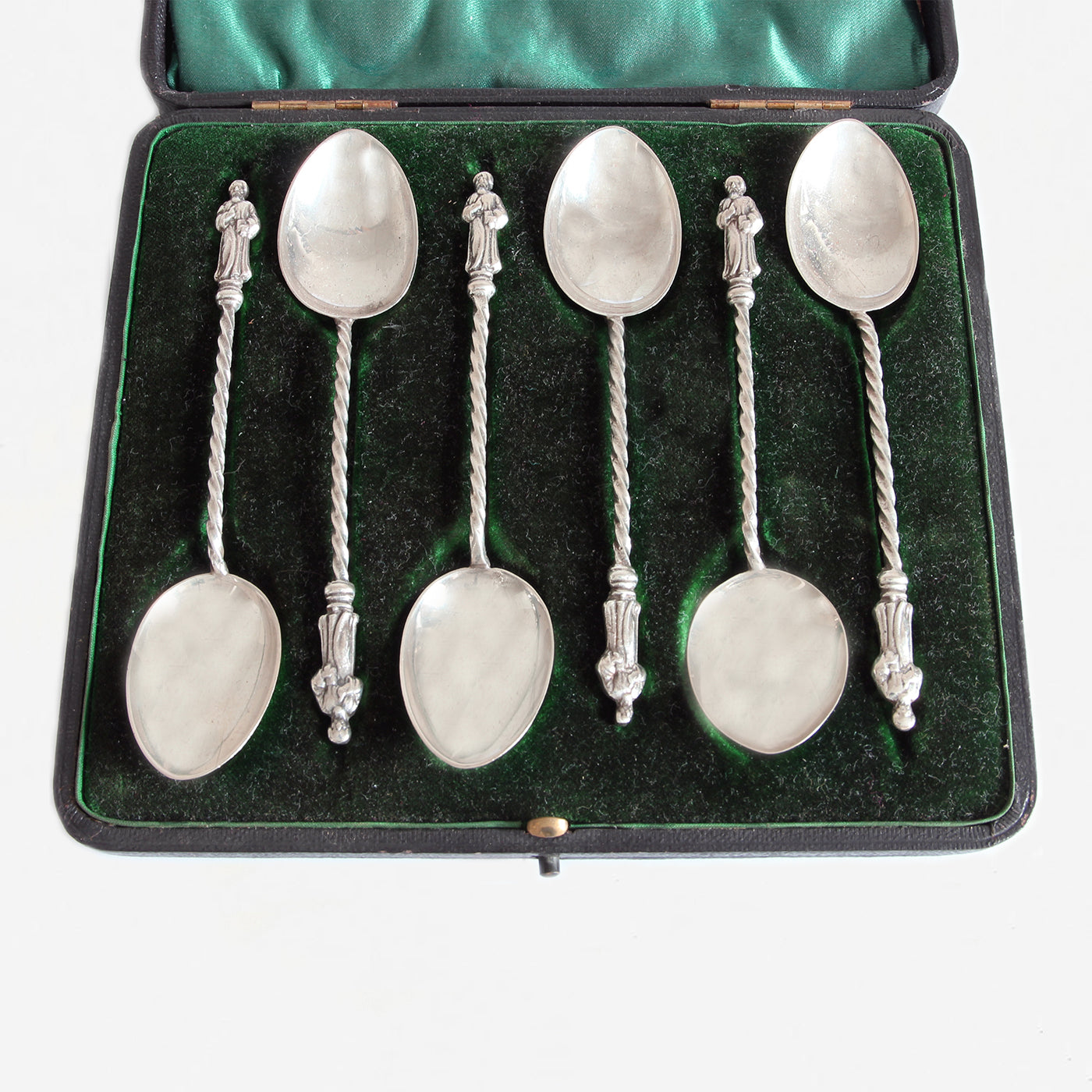 a set of secondhand silver apostle spoons in a green box dated 1901
