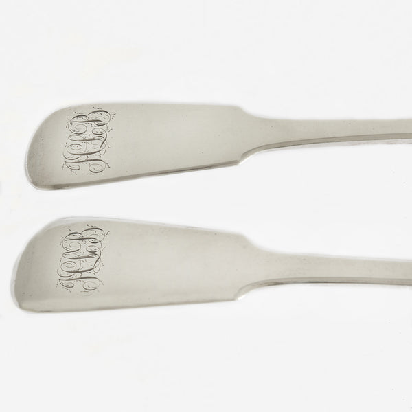 a pair of silver basting spoons dated 1830 with 3 scroll initials