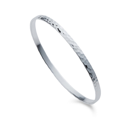 a silver flat hammered design bangle by christin ranger