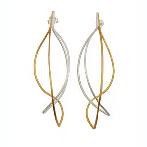 silver and gold plated kinetic drop earrings by christin ranger