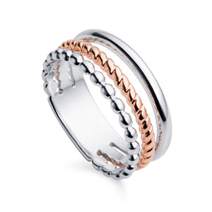 a sterling silver rose gold trio ring by christin ranger