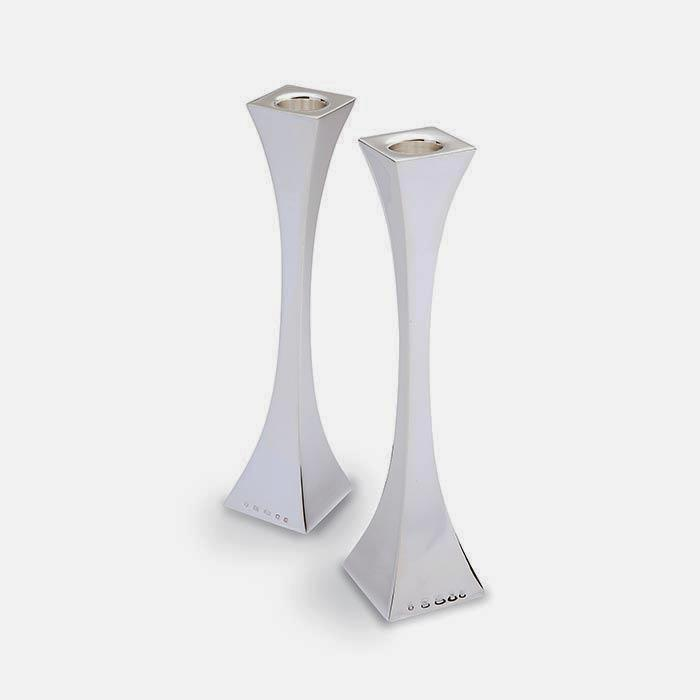 a sterling silver pair of candlesticks with an art deco design with a full hallmark