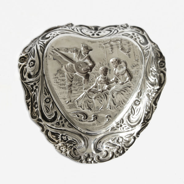 an antique silver heart tray with gentleman and 2 ladies and floral scene dated 1900