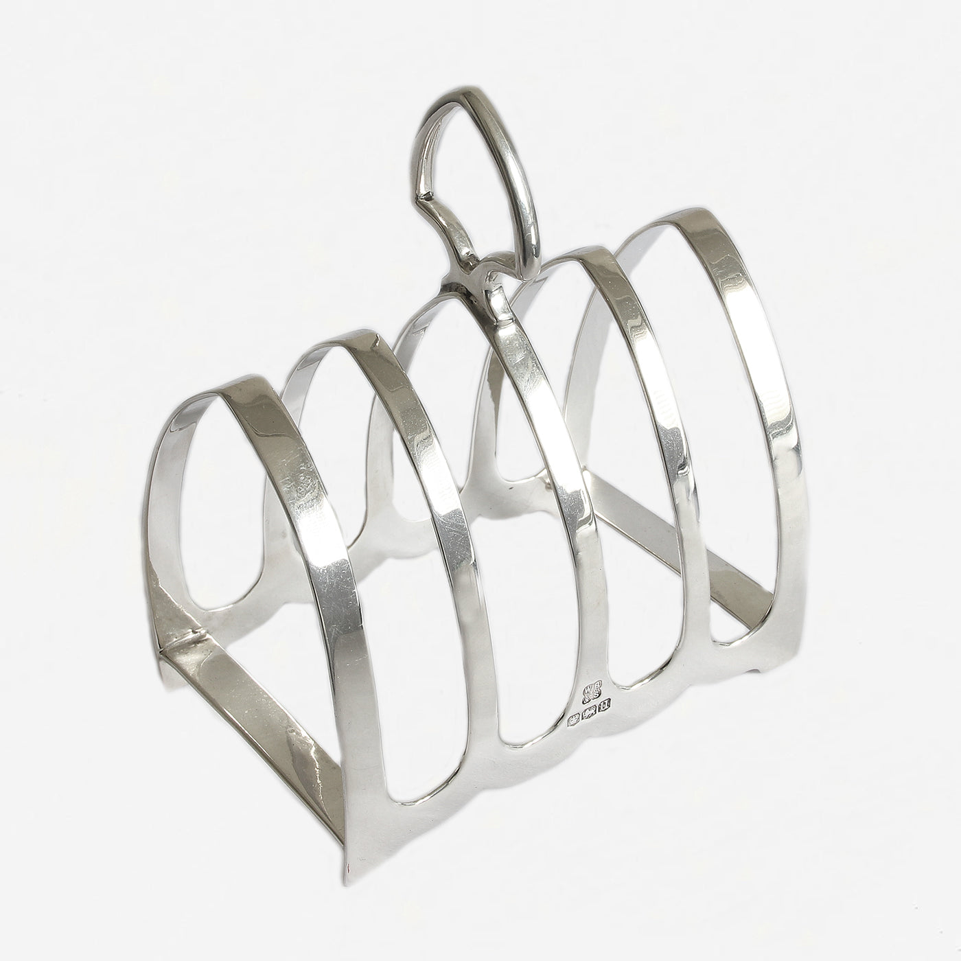 a silver toast rack with 5 arched bars Sheffield 1934