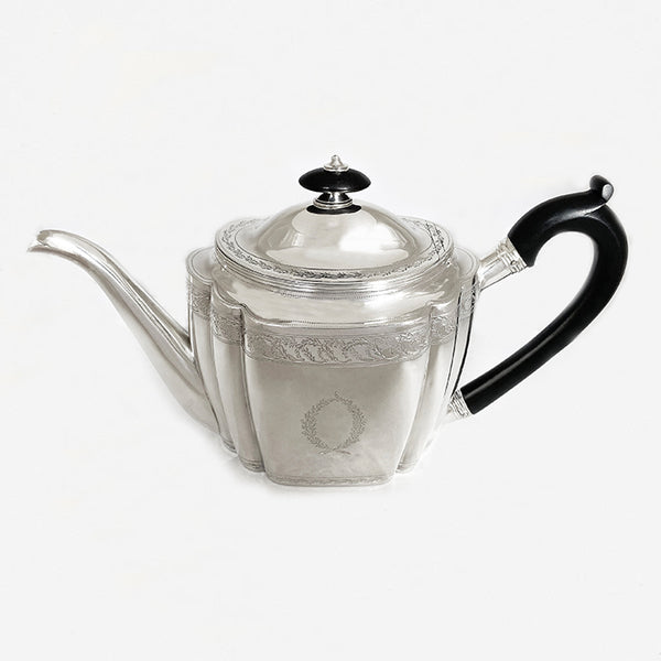 a superb antique george third silver teapot dated London 1800 with family crest lion anchor