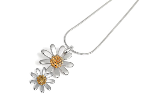 a silver double daisy pendant with snake chain