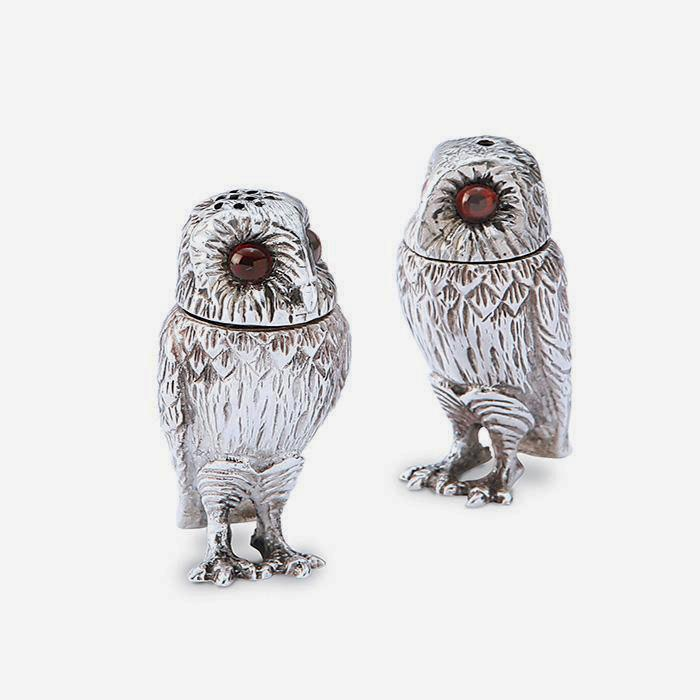 a sterling silver set of salt and pepper in an owl design