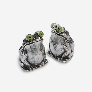 a sterling silver salt and pepper set in an owl design very detailed with green eyes