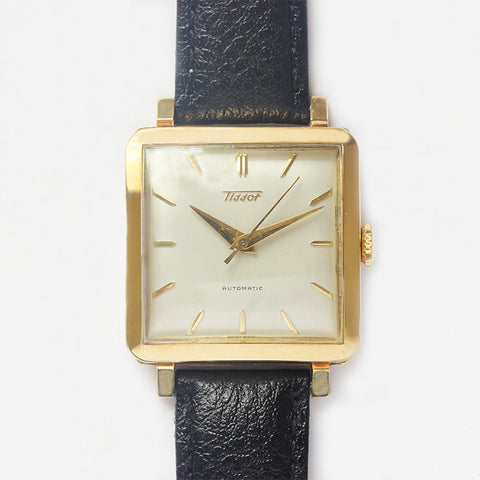 a secondhand preowned tissot gents automatic watch with gold case and leather strap