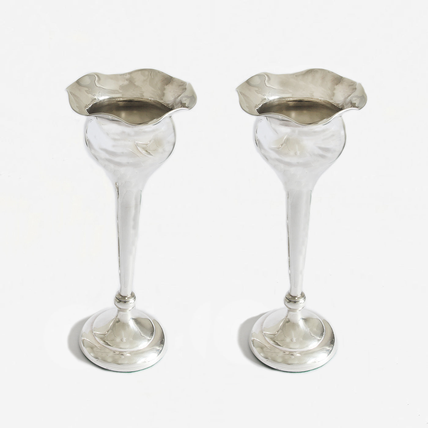 a pair of fluted trumpet vases in silver at Marston barrett
