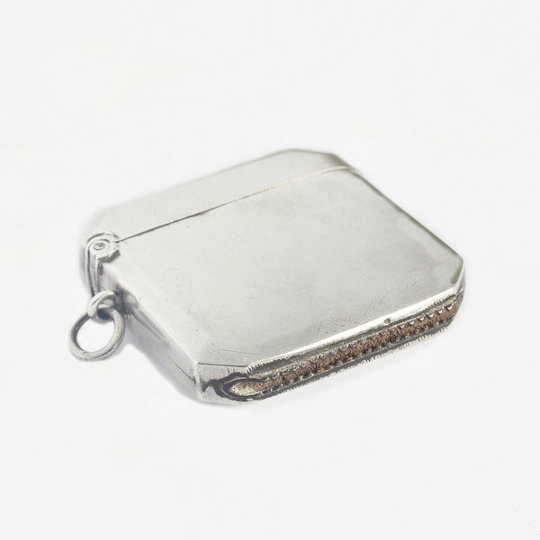 a silver vesta case with plain design and 8 sides and hallmarked 1913
