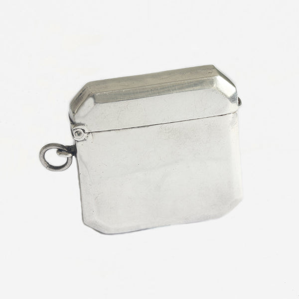 an antique silver plain vesta case with hinge and hallmark dated 1913