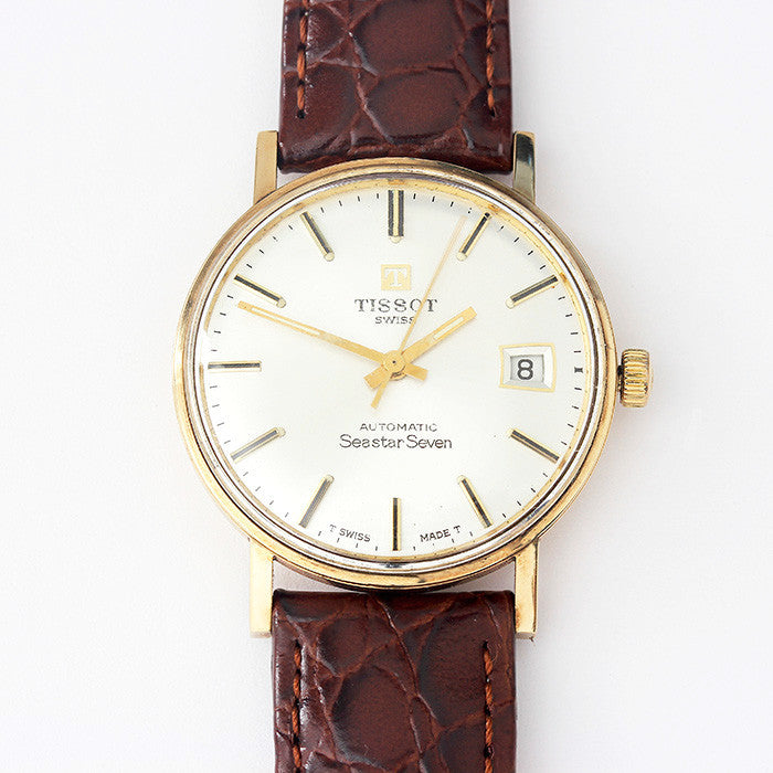 a gents tissot seastar watch with gold case and leather strap 1960's model