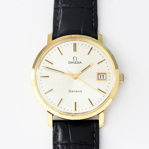 a secondhand gents omega watch geneve model with gold case and leather strap 1974 date