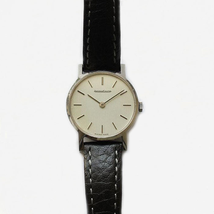 a ladies jaeger le coultre vintage watch with steel case and black leather strap