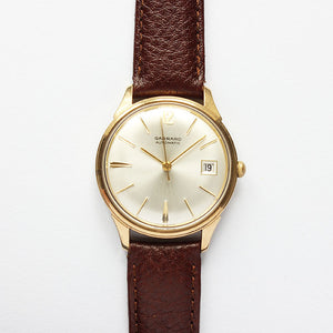 a wonderful garrard automatic mens watch with 9 carat gold case  automatic movement dated 1969