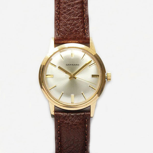 a fine quality vintage garrard mens gold watch with brown leather strap