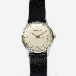 a vintage smiths astral mens watch with black leather strap and steel case